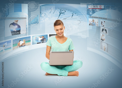 woman with laptop pc and virtual screens
