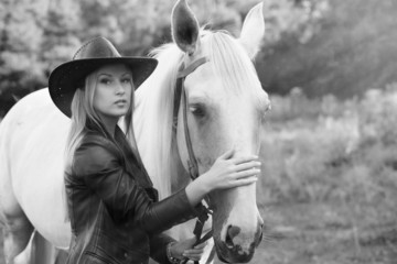 Girl with white horse, desaturated