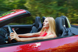 Young woman driving a sports car