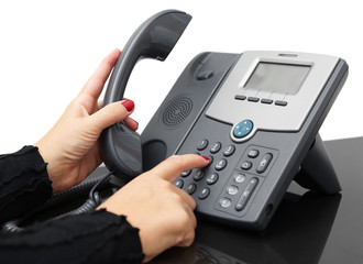 female hand is dialing a phone number