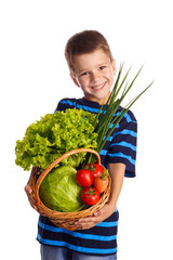 Smiling boy with vegetables