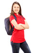 Female student with backpack looking at a camera