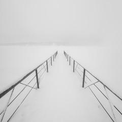 Berth in the fog in winter. Volga river.