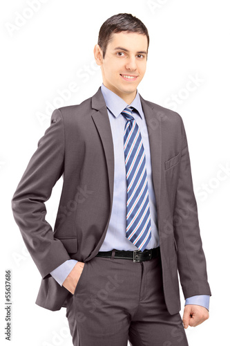 Young businessman wearing grey suit and looking at a camera