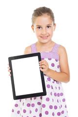 Cute little girl showing blank tablet screen