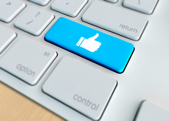 Social Media Concept  - Thumbs up symbol on keyboard