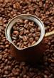 Metal turk on coffee beans background