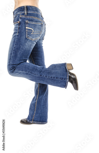Woman Wearing Flared Blue Jeans Isolated on White