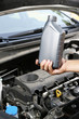 Auto mechanic hand holding motor oil