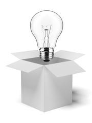 cardboard box with lit light bulb