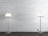 two floor lamps in brick room