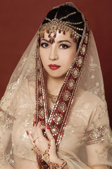 Beautiful asian woman in traditional clothing with bridal makeup