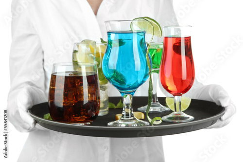 Waitresses holding tray with glasses of cocktails, isolated