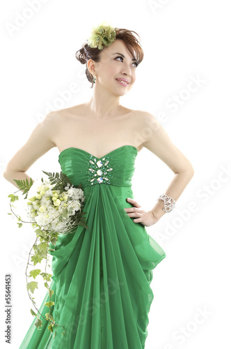 Happy sexy beautiful bride woman l in green wedding dress