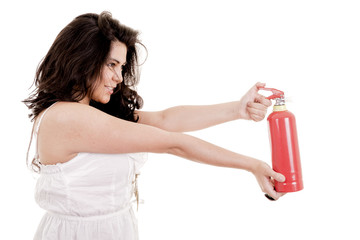 Business woman in holding fire extinguisher