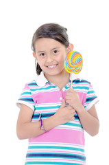 Cute hispanic little girl holding big lolly pop on white
