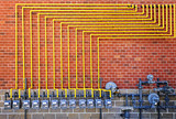 Gas meters on brick wall