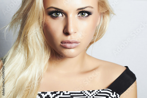 close-up beautiful blond woman with green eyes. cosmetics