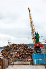 Recycling, loading scrap metal in the ship