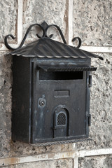 Old weathered black metal mailbox