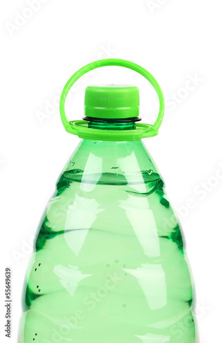 Top of plastic bottle with water without label.