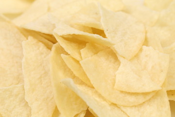 Background of potato chips. Close up.