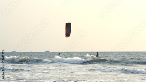 Kiteboarder enjoy surfing in the sea