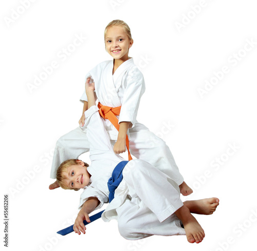 canvas print picture Cheerful kids athletes in kimono doing throws