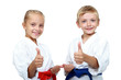 Children athletes with belts show a thumbs up - 55652620