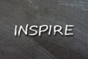 Inspire handwritten with white chalk