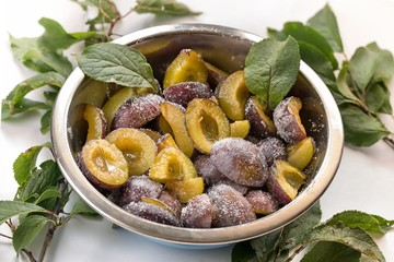 Bowl halved plums sprinkled with sugar