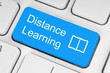 Blue distance learning button on white keyboard.