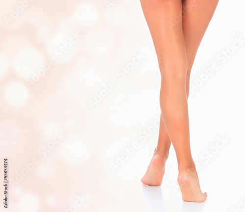 Slim woman legs against abstract background
