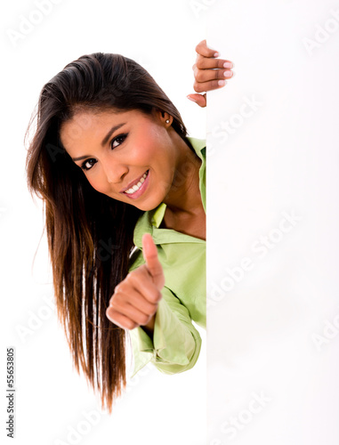 Woman with banner and thumbs up
