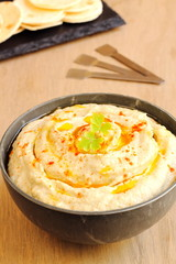 Chickpea hummus with olive oil and paprika and pita bread