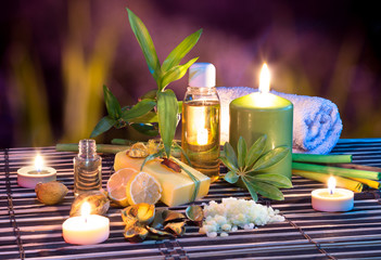 lemon soap , oil, towel, salt, bamboo,  and candles in garden