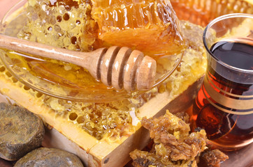 fresh  honeycombs  and wooden stick ,cup of Turkish tea