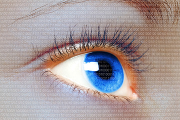 Woman blue eye looking on a digital virtual screen close-up.