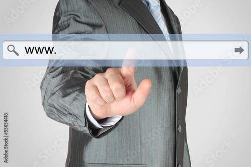 Businessman pushing virtual search bar on grey background