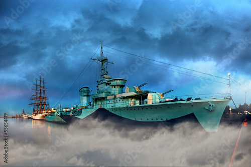 Warship in the port of dramatic scenery.