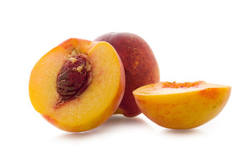 Nectarines over a white background