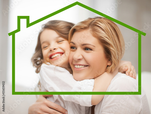 mother and daughter with eco house