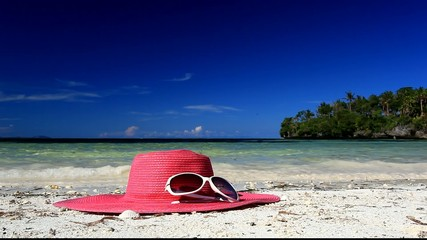 Sun hat and sunglasses on tropical beach, footage