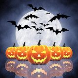 Halloween carved pumpkins ,full moon and bats