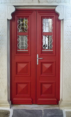 Red wooden entrance door at Mykonos - Greece