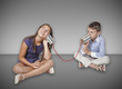 kids talking with tin can telephone