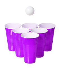 Beer pong. Purple plastic cups and ping pong ball isolated