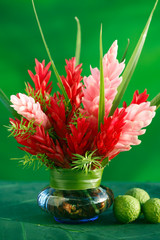 Tropical flowers arrangment in a vase