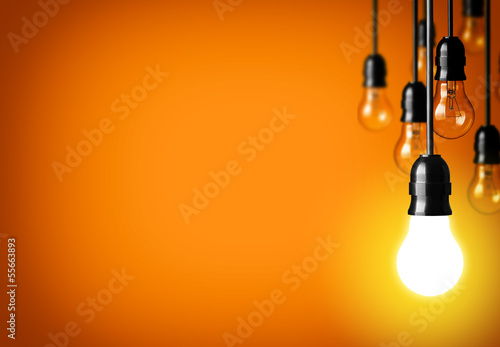 Leinwandbild Motiv Idea concept on orange background.