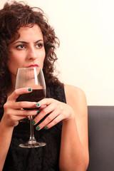 Drinking wine.
